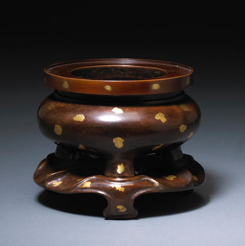 A bronze censer and stand with sunspot decoration