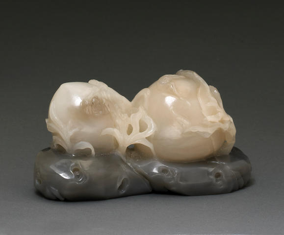 A white jade carving of peaches