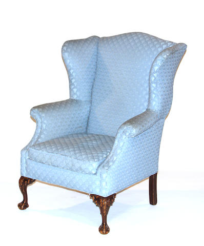 A Chippendale style wing chair