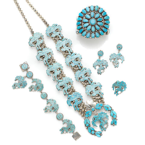 A collection of turquoise and silver jewelry