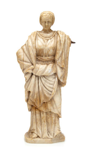 A Continental carved alabaster figure
