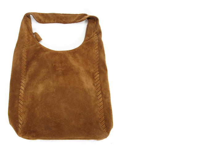 A large Prada brown suede hobo bag