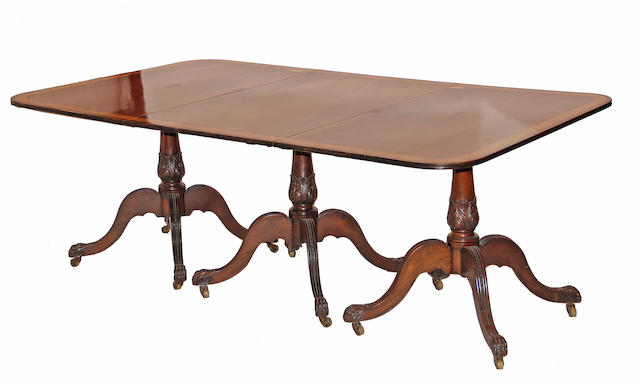A Regency style mahogany and satinwood crossbanded triple pedestal dining table 20th century