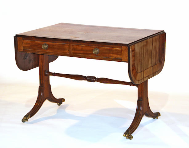 A Regency mahogany and satinwood crossbanded sofa table first quarter 19th century