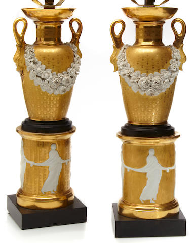 A pair of Paris porcelain parcel gilt and bisque two handled vases mounted as lamps
