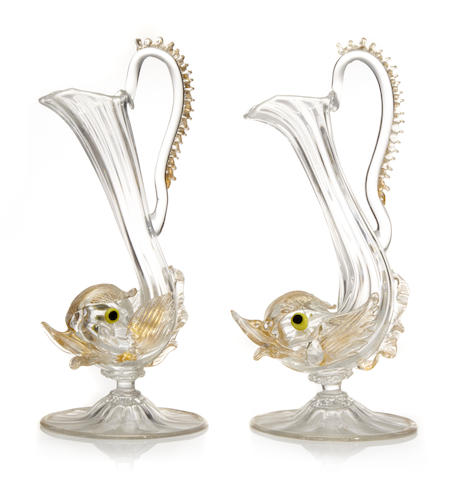 A pair of Venetian glass dolphin form ewers
