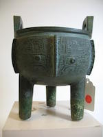 A cast bronze tripod vessel, ding Shang dynasty