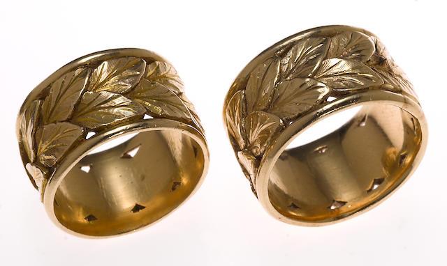 Two 14k gold leaf motif wide bands