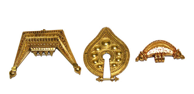 Three Indonesian gold adornments
