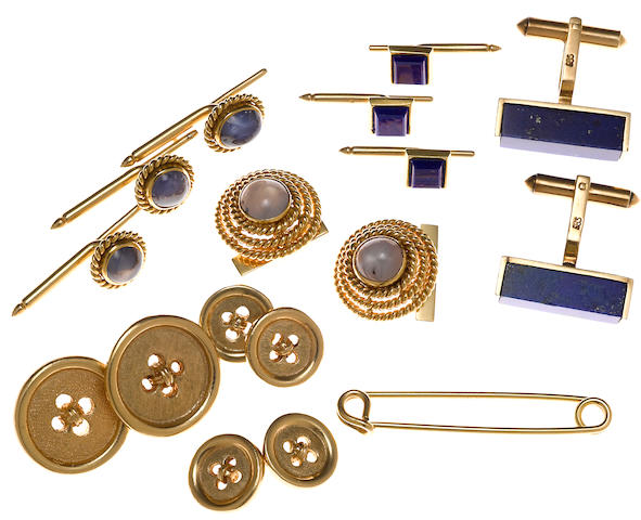 A collection of lapis lazuli, star sapphire, 18k and 14k gold men's jewelry and accessories