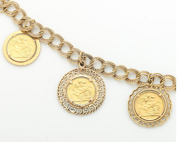 An 18k bicolor gold bracelet suspending three gold coin, 18k and 14k gold charms
