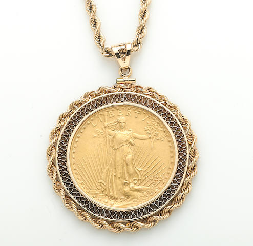 A gold coin and 14k gold pendant with rope chain