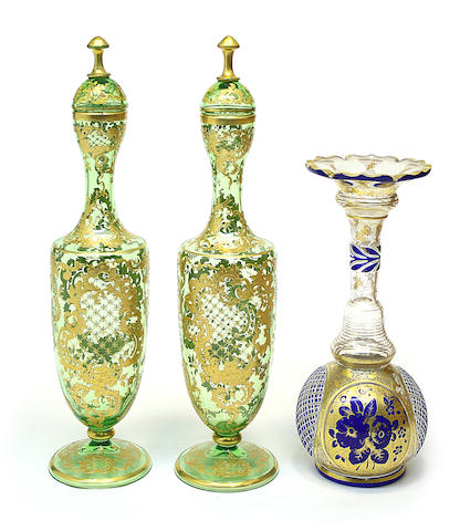 A pair of Bohemian green glass covered vases and a Bohemian double overlay glass vase fourth quarter 19th century