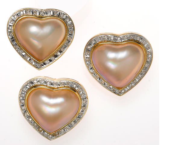 A heart-shaped mabé cultured pearl, diamond and 14k gold ring together with a matching pair of earrings