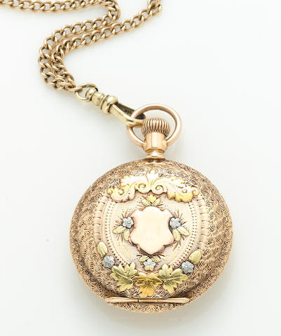 A 14k tricolor gold hunter cased pocket watch with 14k gold chain American Waltham