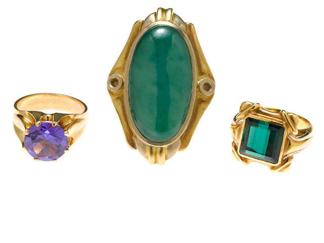 A collection of three jadeite jade, green tourmaline, synthetic color change sapphire, 14k and 18k gold rings