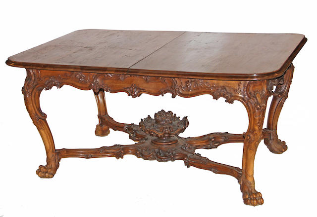 A Louis XV style walnut extension dining table first half 20th century