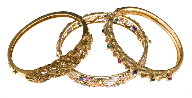 Two gem-set, diamond and 14k gold bangle bracelets together with a synthetic gem, diamond simulant and 14k tricolor gold bangle bracelet