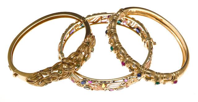 Two gem-set, diamond and 14k gold bangle bracelets together with a synthetic gem, diamond simulant and 14k tricolor gold bangle bracelet