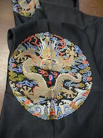 A Manchu prince's black satin surcoat, guanfu Late Qing dynasty