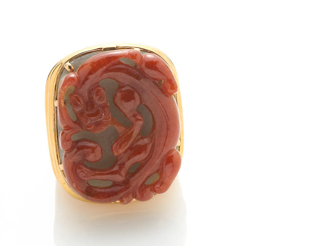 A carved jadeite jade and 18k gold ring