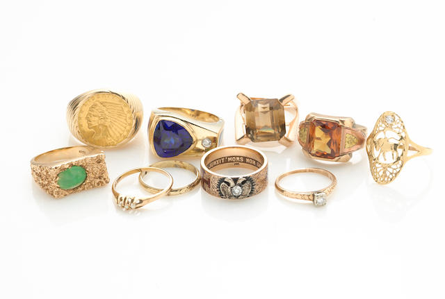 A collection of ten gold coin, jade, diamond, citrine, glass, cubic zirconia, 14k and 10k gold rings