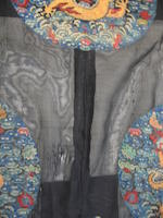 A Manchu noblewoman's embroidered black gauze summer surcoat, longgua Late 19th century