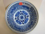 A blue and white porcelain bowl with famille rose enameled lotus decoration Guangxu mark and period