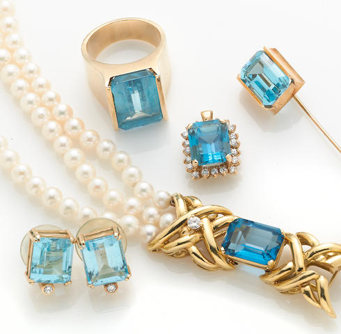 A collection of four blue topaz, diamond, and 14k gold jewelry pieces together with a blue topaz, cultured pearl, diamond and 18k gold bracelet