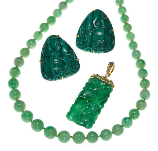 A collection of jadeite jade, malachite and 14k gold jewelry