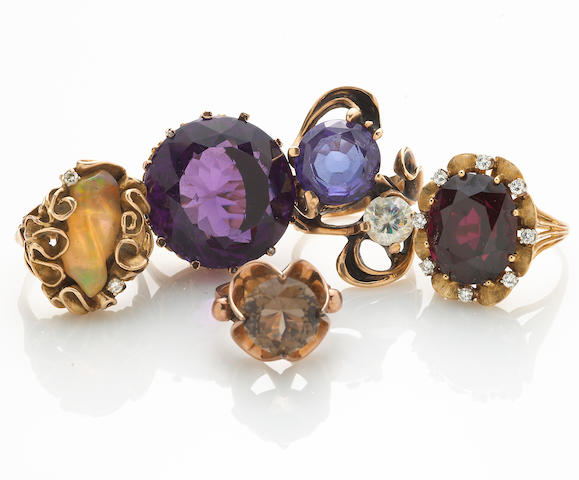 A collection of five gem-set, synthetic color change sapphire, diamond, diamond simulant, 18k and 14k gold rings