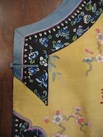A Manchu noblewoman's yellow ground kesi-woven silk long vest Late Qing dynasty