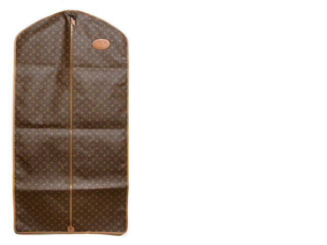 A Louis Vuitton monogram garment bag