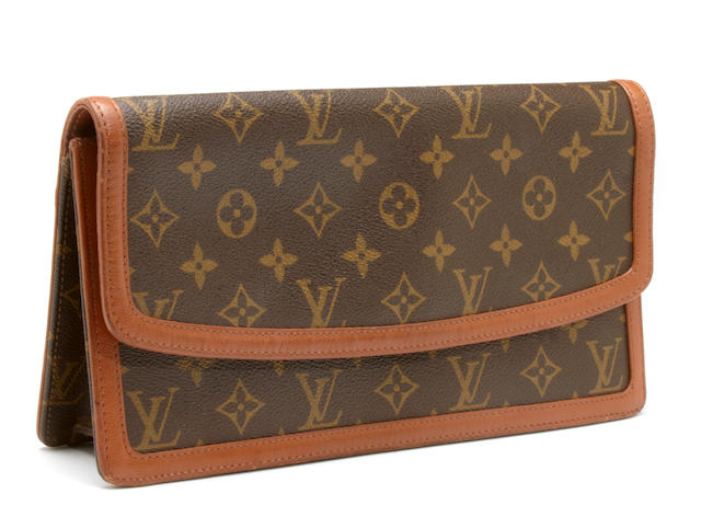 A Louis Vuitton monogram clutch
