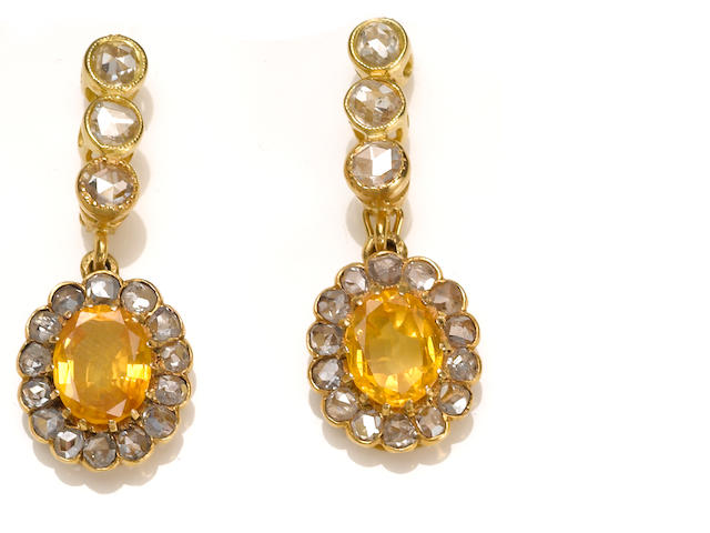 A pair of yellow sapphire, diamond and 18k gold pendant earrings