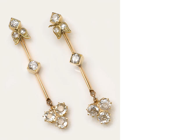 A pair of diamond and 14k gold pendant earrings