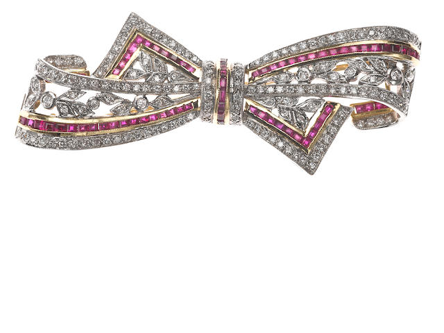 A ruby, diamond, and 18k bicolor gold bow brooch