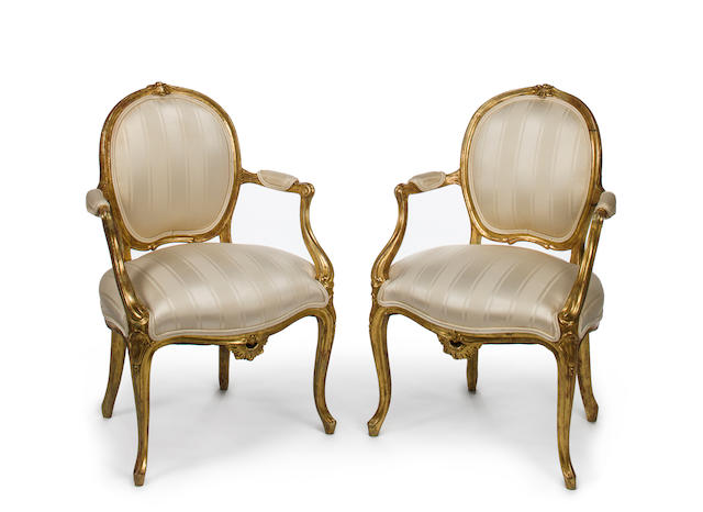 A pair of George III giltwood armchairs in the French taste<BR />fourth quarter 18th century