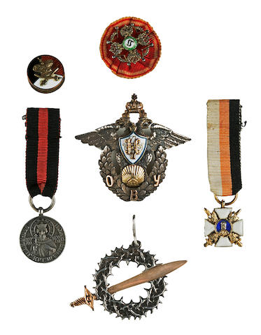 An Odessa military school graduation badge with other Russian medals and insignia