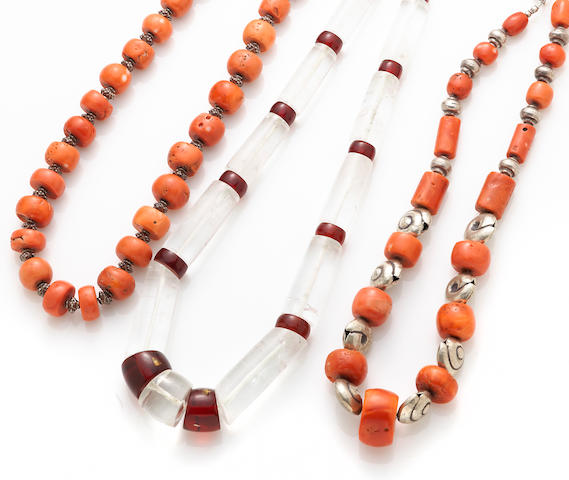 Two coral and silver necklaces together with a rock crystal, paste and dyed quartz necklace