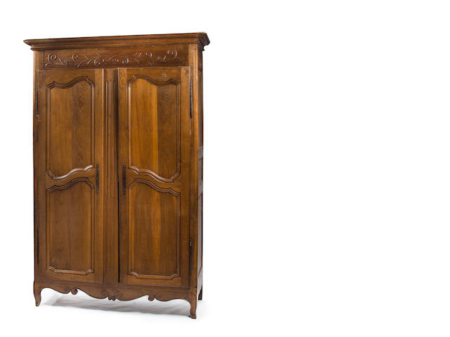 A Louis XV provincial oak armoire, significant losses to side of leg, parts detached from back