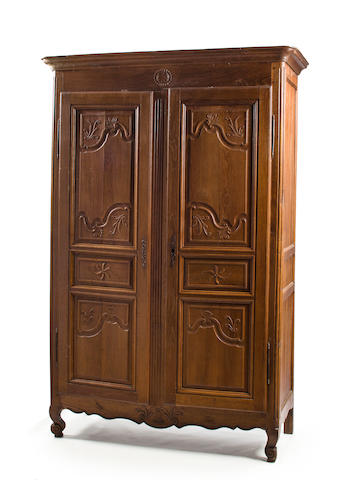 A Louis XV provincial walnut armoire, holes and wear to finish