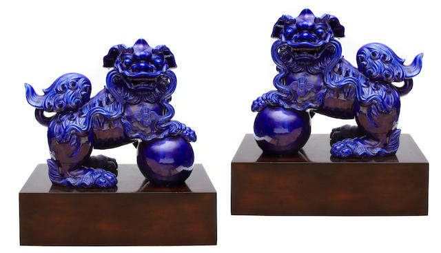 A pair of blue glazed porcelain fu lions