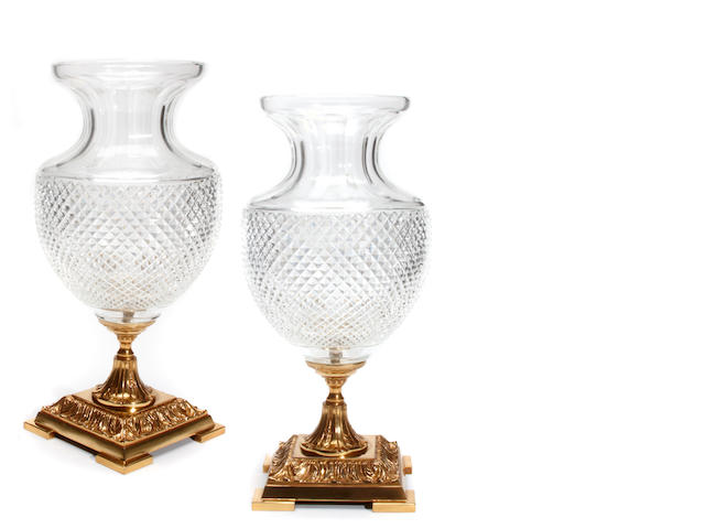 A pair of gilt metal and cut glass vases