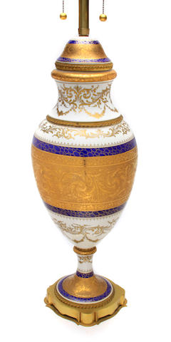 A Continental porcelain gilt heightened table lamp