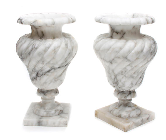 A pair of Neoclassical style carved alabaster urns