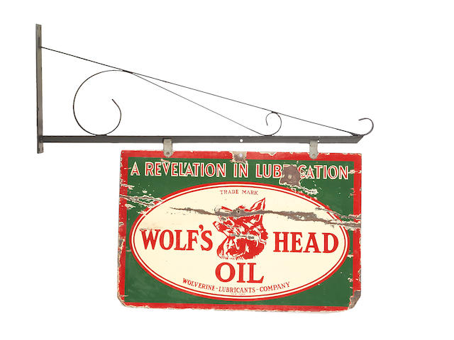 A rare Wolf's Head Motoroil sign, c. 1910,