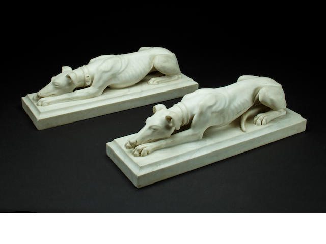 Pair of Italian, late 19th/early 20th century, Carrara marble recumbent Greyhounds