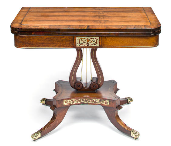 A Regency style rosewood and brass inlaid games table<BR />early 19th century and later