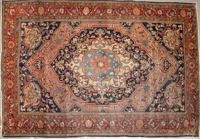 A Baktiari indigo ground wool rug circa 1920 size approximately 9ft. 11in. x 6ft. 11in.